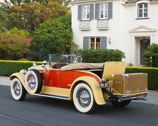 AUT 18 RK0853 01 © Kimball Stock 1927 Packard Series 6 Roadster Yellow And Orange 3/4 Rear View On Pavement By House
