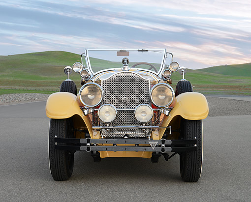 AUT 18 RK0854 01 © Kimball Stock 1927 Packard Series 6 Roadster Yellow And Orange Front View On Pavement By Grassy Hills