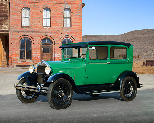 AUT 18 RK0855 01 © Kimball Stock 1928 Ford Model A Tudor Sedan Balsam Green 3/4 Side View On Pavement By Brick Building