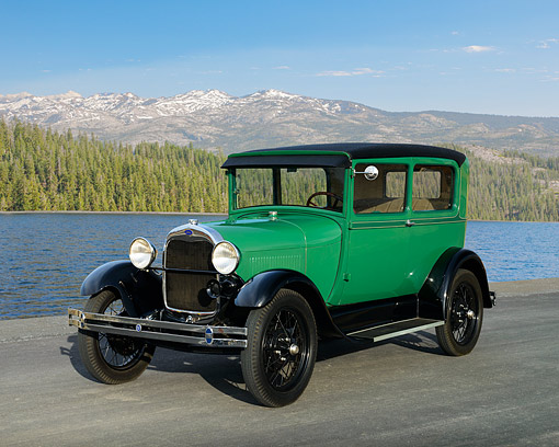 AUT 18 RK0856 01 © Kimball Stock 1928 Ford Model A Tudor Sedan Balsam Green 3/4 Front View On Pavement By Lake And Mountains