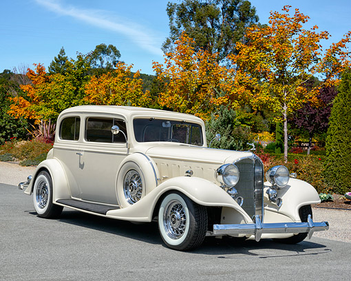 AUT 18 RK0858 01 © Kimball Stock 1925 Buick 29-57 White 3/4 Front View Under Fall Trees