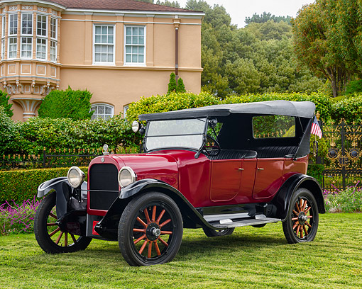 AUT 18 RK0860 01 © Kimball Stock 1923 Dodge Brothers Touring Car Red And Black 3/4 Front View On Grass By Mansion