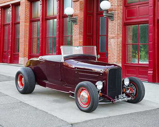 AUT 18 RK0863 01 © Kimball Stock 1929 Ford Highboy Maroon 3/4 Front View By Brick Building