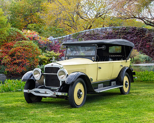 AUT 18 RK0865 01 © Kimball Stock 1923 Studebaker Big Six Touring Yellow 3/4 Front View By Bridge In Autumn
