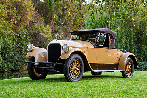 AUT 18 RK0866 01 © Kimball Stock 1924 Pierce-Arrow Runabout E-1A Beige 3/4 Front View By Trees