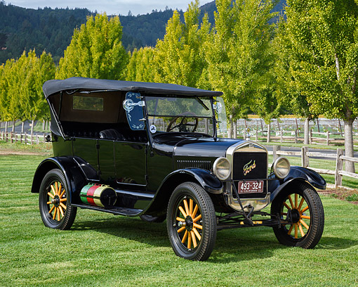 AUT 18 RK0867 01 © Kimball Stock 1927 Ford Model T Tourning Black 3/4 Front View By Fence And Trees