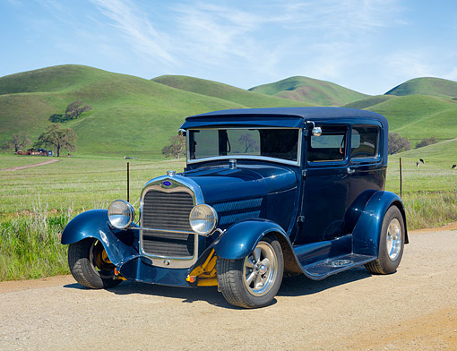 AUT 18 RK0876 01 © Kimball Stock 1928 Ford Tudor Blue 3/4 Front View On Farm By Hills