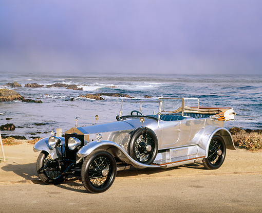 AUT 18 RK0049 05 © Kimball Stock 1921 Rolls-Royce Silver Ghost Tourer 3/4 Front View On Sand By Ocean Waves