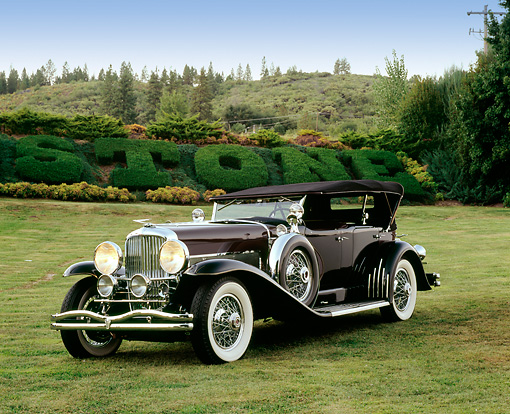 AUT 18 RK0067 01 © Kimball Stock 1929 Duesenberg Phaeton Dual Cowl Black 3/4 Front View On Grass By Mountain