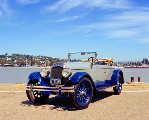 AUT 18 RK0083 02 © Kimball Stock 1926 Locomobile Convertible Gray And Blue 3/4 Front View On Pavement By Water