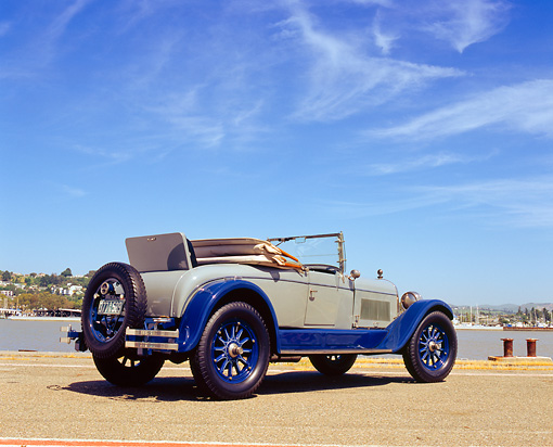 AUT 18 RK0087 01 © Kimball Stock 1926 Locomobile Convertible Blue And Gray 3/4 Rear View On Pavement By Water