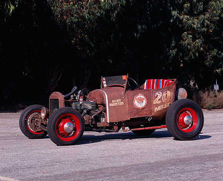 AUT 18 RK0290 02 © Kimball Stock 1926 Ford Roadster Rusty Brown 3/4 Side View On Pavement Trees