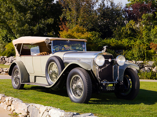AUT 18 RK0295 01 © Kimball Stock 1923 Hispano Suiza H6-B Touring Dual Windshield French Gray Front 3/4 View On Grass By Trees Stone Wall