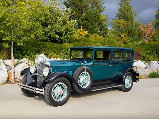 AUT 18 RK0312 01 © Kimball Stock 1929 Packard 645 Deluxe Limo Green & Black 3/4 Front View By Trees