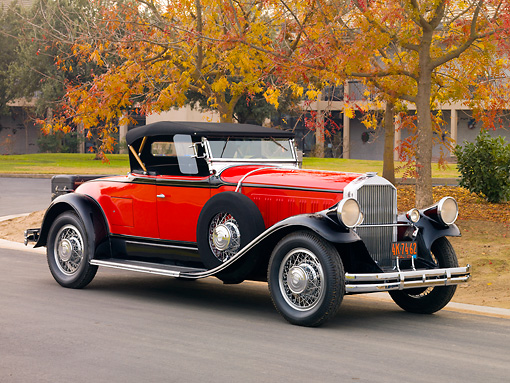 AUT 18 RK0325 01 © Kimball Stock 1929 Pierce-Arrow Series 133 Roadster Red And Black 3/4 Front View On Pavement By Trees