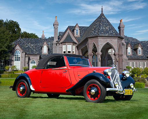 AUT 19 BK0002 01 © Kimball Stock 1938 Citroen Traction Avant Roadster Red And Black 3/4 Front View On Grass By Mansion