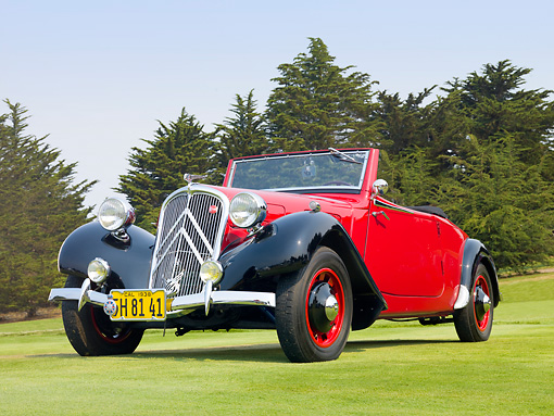 AUT 19 BK0003 01 © Kimball Stock 1938 Citroen Traction Roadster Red And Black 3/4 Front View On Grass By Trees
