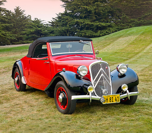 AUT 19 BK0004 01 © Kimball Stock 1938 Citroen Traction Roadster Red And Black 3/4 Front View On Grass By Trees