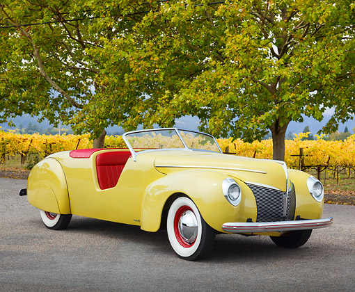 AUT 19 BK0005 01 © Kimball Stock 1939 Coachcraft Mercury Roadster Cigarette Cream 3/4 Front View On Pavement By Vineyard