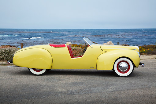 AUT 19 BK0006 01 © Kimball Stock 1939 Coachcraft Mercury Roadster Cigarette Cream Profile View On Pavement By Ocean
