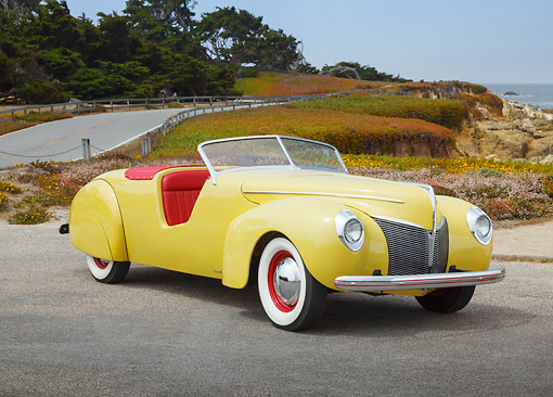 AUT 19 BK0007 01 © Kimball Stock 1939 Coachcraft Mercury Roadster Cigarette Cream 3/4 Front View On Pavement By Beach