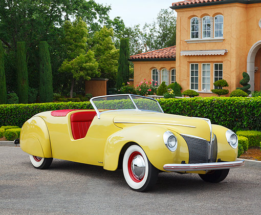 AUT 19 BK0009 01 © Kimball Stock 1939 Coachcraft Mercury Roadster Cigarette Cream 3/4 Front View On Pavement By House