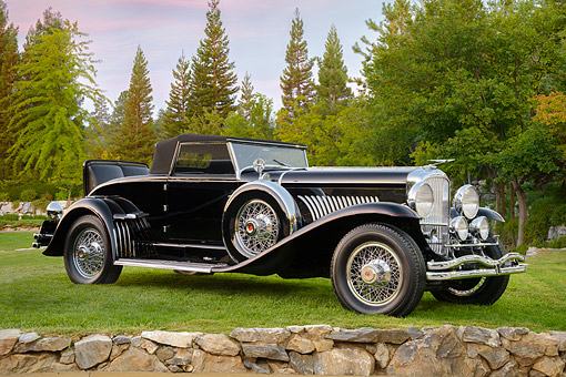 AUT 19 BK0010 01 © Kimball Stock 1931 Duesenberg J Murphy Roadster Black 3/4 Front View On Grass By Trees