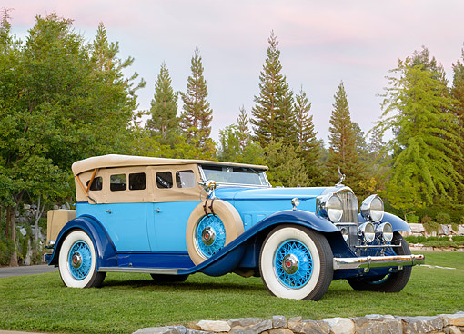 AUT 19 BK0012 01 © Kimball Stock 1932 Packard 902 Phaeton Roadster Blue 3/4 Front View By Trees