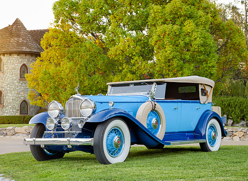 AUT 19 BK0013 01 © Kimball Stock 1932 Packard 902 Phaeton  Roadster Blue 3/4 Front View By Castle And Trees