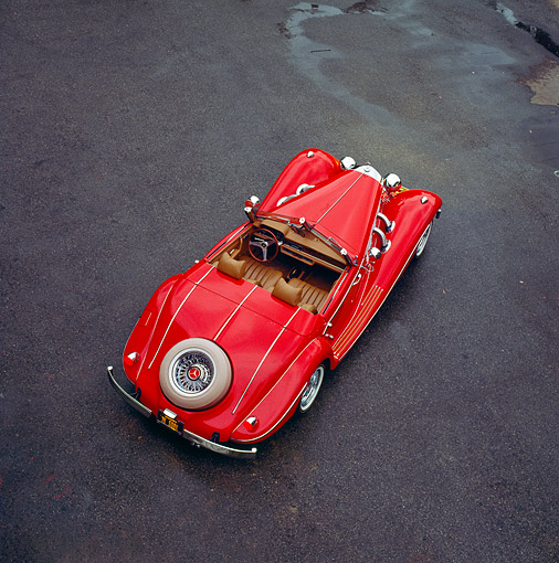 AUT 19 RK0075 02 © Kimball Stock 1936 Mercedes-Benz Convertible Red Overhead Rear 3/4 View On Pavement