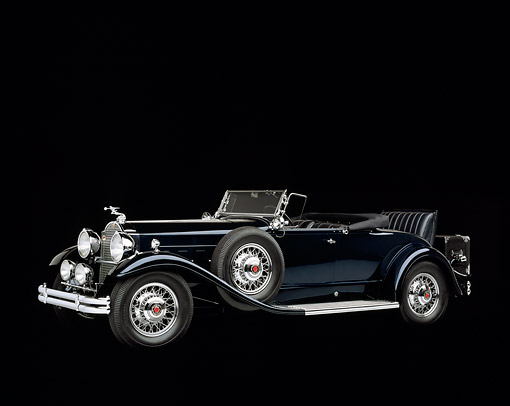 AUT 19 RK0083 02 © Kimball Stock 1930 Packard 850 Roadster Blue 3/4 Side View Studio