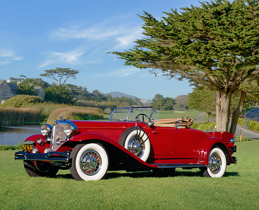 AUT 19 RK0119 06 © Kimball Stock 1931 Chrylser Imperial CG Le Baron Roadster Red 3/4 Side View On Grass By Pond