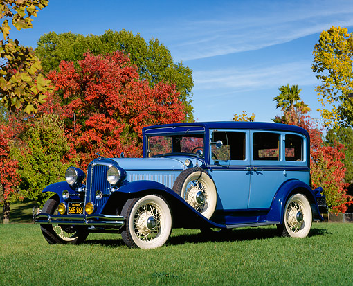 AUT 19 RK0121 06 © Kimball Stock 1931 Chrysler Sedan Model CM 6 Cylinder 3/4 Front View On Grass By Autumn Trees