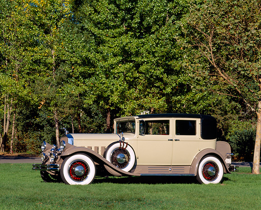AUT 19 RK0123 01 © Kimball Stock 1930 Pierce Arrow Club Sedan Beige 3/4 Side View On Grass By Trees
