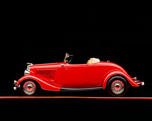 AUT 19 RK0154 02 © Kimball Stock 1934 Ford Roadster Red Side View On Red Line Studio
