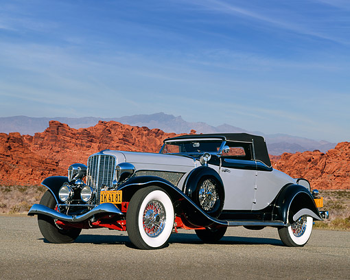 AUT 19 RK0245 11 © Kimball Stock 1934 Auburn Model 1250 Gray 3/4 Front View On Pavement In Desert