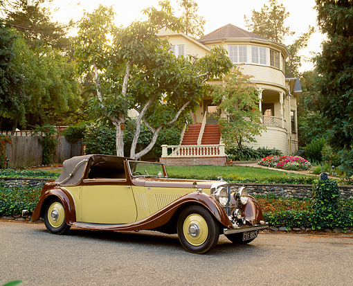 AUT 19 RK0249 05 © Kimball Stock 1936 Bentley Gurney Nutting Drophead Coupe Yellow And Brown 3/4 Side View By House