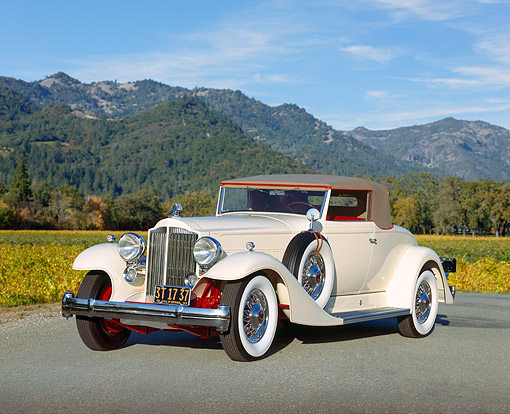 AUT 19 RK0253 04 © Kimball Stock 1933 Packard V-12 Coupe White 3/4 Front View On Pavement By Hills