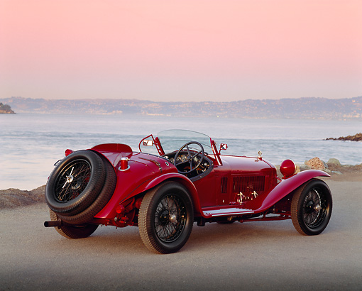 AUT 19 RK0259 08 © Kimball Stock 1932 Alfa Romeo 2300 Touring Spider 8C Red 3/4 Rear View On Dirt By Ocean At Dusk