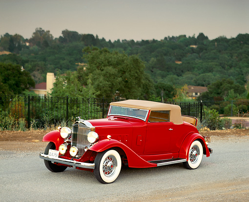 AUT 19 RK0274 01 © Kimball Stock 1933 Packard 1001 Coupe Red Front 3/4 View On Road Hills Background Filtered