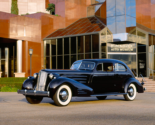 AUT 19 RK0324 05 © Kimball Stock 1934 Cadillac V-16 Aerodynamic Coupe Purple 3/4 Side View On Pavement By Museum