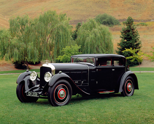 AUT 19 RK0338 02 © Kimball Stock 1930 Bentley Speed Six Corsica Coupe Black 3/4 Side View On Grass