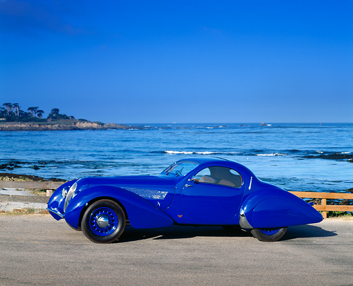 AUT 19 RK0355 04 © Kimball Stock 1937 Talbot Lago Blue 3/4 Side View On Pavement By Ocean Blue Sky