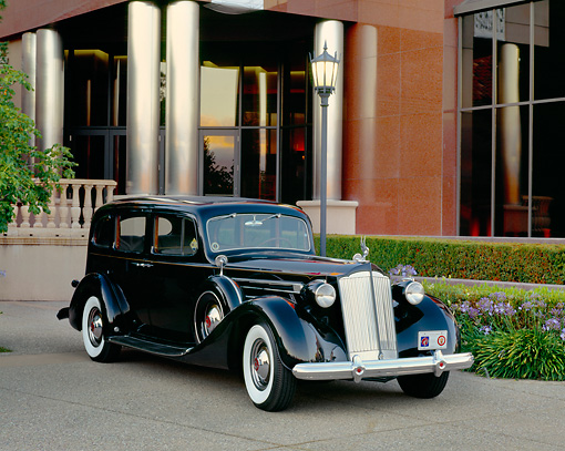 AUT 19 RK0361 05 © Kimball Stock 1937 Packard Twelve Model 1508 Touring Sedan Black Front 3/4 View By Museum