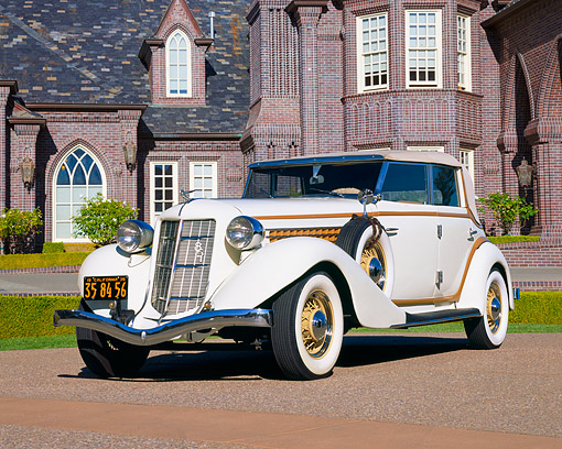 AUT 19 RK0368 06 © Kimball Stock 1935 Auburn Model 851 Phaeton Cream 3/4 Front View On Pavement By Mansion