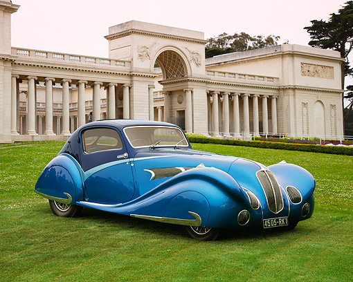 AUT 19 RK0436 01 © Kimball Stock 1936 Delahaye 135 Competition Coupe Blue 3/4 Side View On Grass By Building With Columns