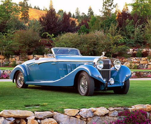 AUT 19 RK0441 02 © Kimball Stock 1934 Hispano Suiza J12 Cabriolet Blue 3/4 Front View On Grass By Trees