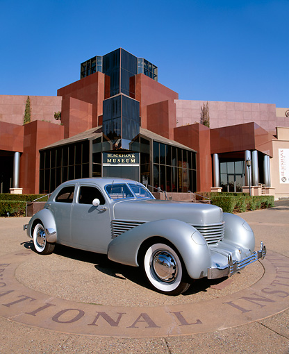 AUT 19 RK0474 02 © Kimball Stock 1936 Cord Westchester Model 810 Silver Wide Angle 3/4 Front View In Front Of Museum