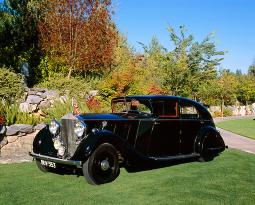 AUT 19 RK0570 02 © Kimball Stock 1937 Rolls Royce PIII Limousine Black 3/4 Side View On Grass By Trees