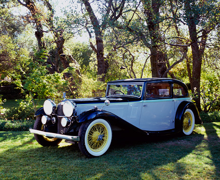 AUT 19 RK0618 03 © Kimball Stock 1934 Alvis Speed 20 Green And Gray 3/4 Front View On Grass By Trees